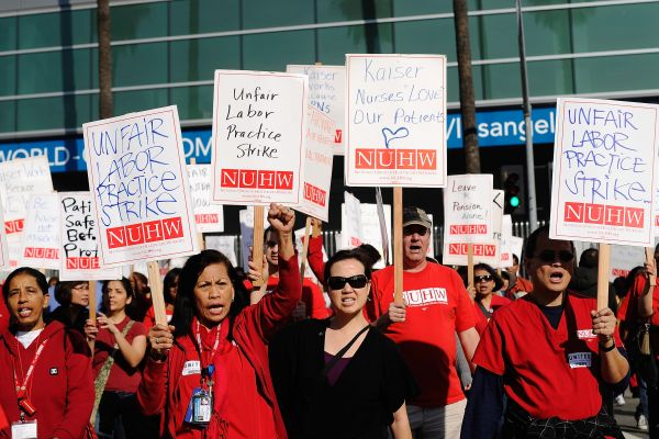Unionized nurses and healthcare workers from the Kaiser Permanente Los Angeles Medical Center take part in a 24-hour strike on January 31, 2012 in Los Angeles, California.