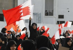 Shi'ite Bahraini protesters wave Bahrain flags during an anti-government gathering in Jidhafs village, east of Manama