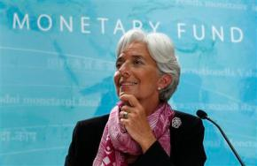 IMF managing director Christine Lagarde holds a press briefing at the International Monetary Fund headquarters in Washington