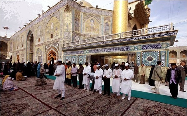 Sunni Muslims Praying at the Holy Shrine of Hazrat Ali a.s in Najaf , Iraq