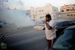 Bahraini Protester in Tear Gas Shells