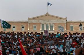 Immigrants living in Greece take part in a rally in front of the parliament as they protest against racism attacks in Athens