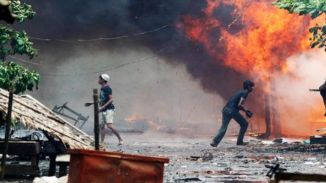 Rohingya Muslims Houses set on fire by Extremist Budhist