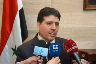 Syrian Prime Minister Wael al- Halqi