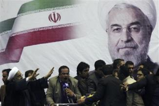 Iranian presidential candidate Rohani waves to supporters in the central Iranian city of Shiraz