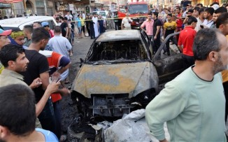65 Killed in Bomb Blasts around Iraq