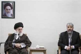 File picture shows Iran's Supreme Leader Ayatollah Khamenei looking on as Hamas leader Meshaal speaks during official meeting in Tehran