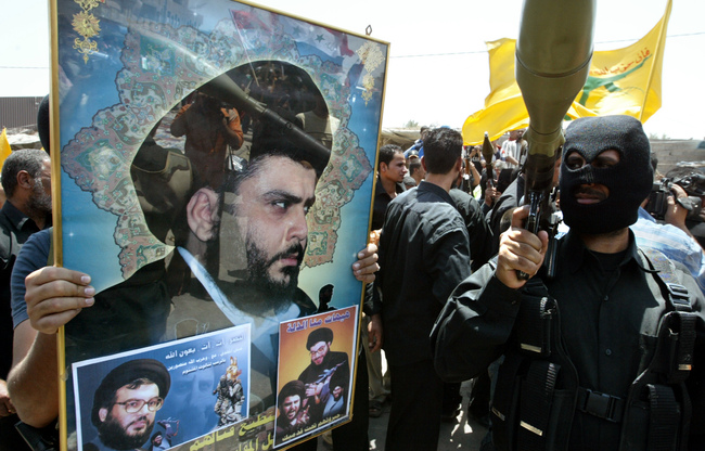 Iraq's Shiite Malatias Vows to attack US Interests