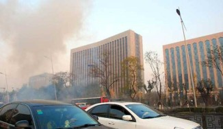 Blasts hit provincial HQ of China communist party; 1 killed, 8 injured