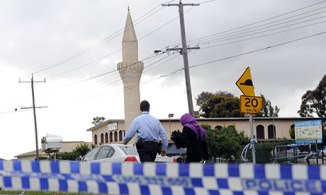 Police at the Broadmeadows Turkish Islamic Cultural Centre on Thursday.