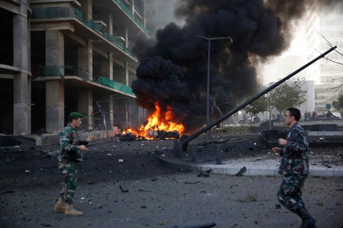 Lebanese army personnel run at the site of an explosion in Beirut's downtown area