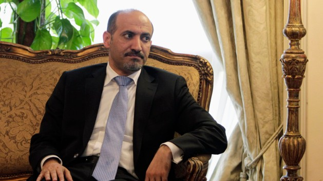 President of the Syrian National Coalition Ahmad Al-Jarba looks on during his meeting with Egypt's Foreign Minister Nabil Fahmy  in Cairo