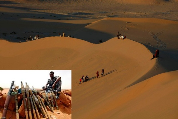 Residents walk on sand dunes in the Libyan desert oasis town of Ghadames