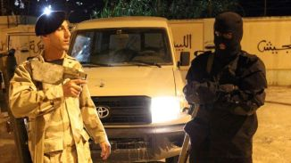 Libyan Security Forces Stand Guard at the CheckPoint