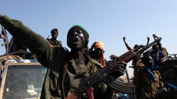 SPLA soldiers sing as they celebrate in Bentiu, Unity state