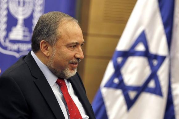 Lieberman, head of the far-right Yisrael Beitenu party, attends a Likud-Beitenu faction meeting at the Knesset in Jerusalem