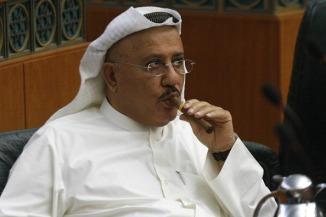 Kuwaiti MP Nabil al-Fadel smokes a cigar