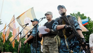 Self-styled governor of Luhansk region Bolotov delivers speech during rally to mark and celebrate announcement of results of referendum on status of Luhansk region in Luhansk