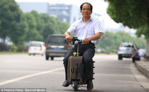 Suitcase MotorBike with its Owner a