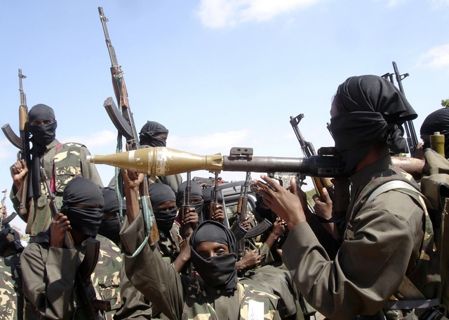 Militants of al Shabaab display their weapons on the outskirts of Mogadishu