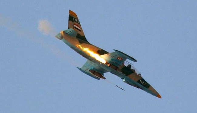Syria pounds ISIL positions in coordination with Iraq