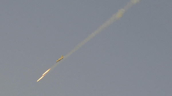A Syrian Air Force fighter plane fires a rocket during an air strike loyal to Syria's President Bashar al-Assad in Raqqa province, eastern Syria