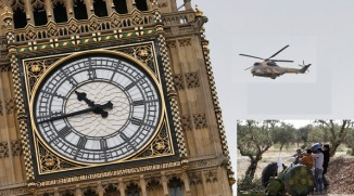 A French Puma Support helicopter from the French Army Air Corps flies past the Big Ben clock tower as it participates in a training exercise in London