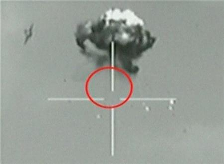 A still image taken from IDF video footage shows what they say is a small unidentified aircraft shot down in a mid-air interception after it crossed into southern Israel