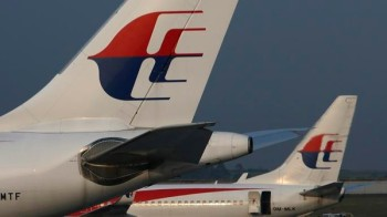 Malaysia Airlines planes sit on the tarmac at Kuala Lumpur International Airport