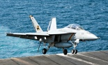 A US warplane lands on an aircraft carrier in the Gulf after bombing Islamic State targets in Syria