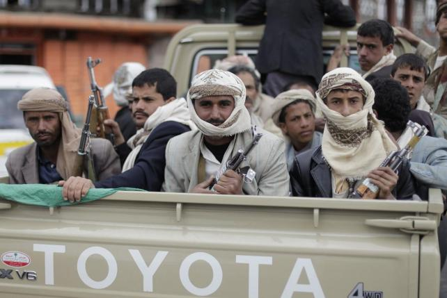 File photo shows Shi'ite Houthi rebels riding a patrol truck in Sanaa