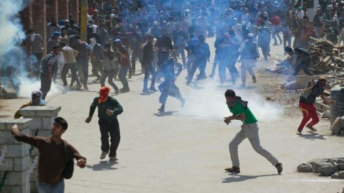 Youth Protesting against security forces in Indian Occupied Kashmir d