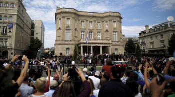 People attend the opening of the new Cuban embassy in Washington