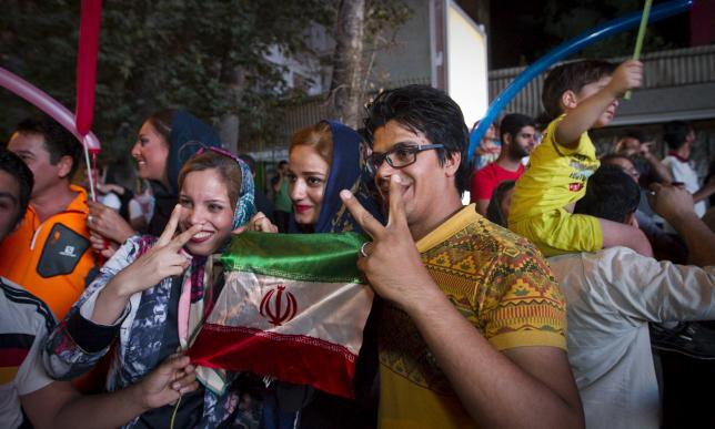 Iranians gesture as they celebrate in the street following a nuclear deal with major powers, in Tehran July 14, 2015. REUTERS/TIMA