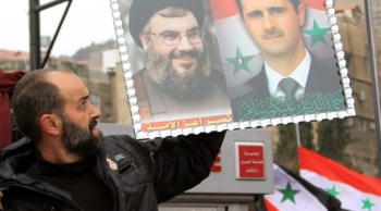 Syrian forces with Hezbollah fighters March to Re Captue Al Zobdani