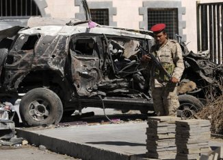Survivors visit the site of bombing at Yemen's Defense Ministry